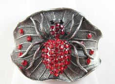 Tibetean Silver Cuff Spider Bracelet with Glass Stones and Rhinestones (Red) Gifts By Lulee. $24.99. in a design of perennial beauty - foldover closure. Tibetean silver - glass beads - rhinestones. this spider bracelet encircles the wrist with its lavish style showcasing the stones and rhinestones