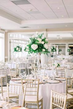 The simplicity and elegance of all white wedding decor can be stunning and breathtaking.  White tablecloths with a light gold chiavari chair and white floral keep the Davenport Country Club in Davenport, IA clean and crisp.