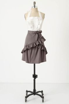 looks like an outfit, skirt and blouse rather than an apron. Cute, but way too fancy for this household.