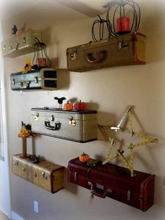 Old Suitcases used as shelves, this is super cute!  it would be great in a bed and breakfast or in your guest room!  Super idea
