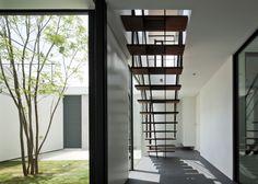 Fleuve house and hair salon by Apollo Architects & Associates