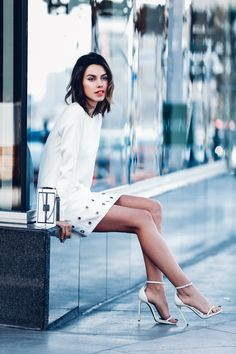 all white outfit with chic clutch                                                                                                                                                                                 More