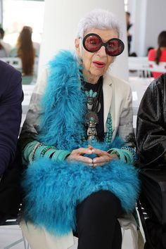 Iris Apfel mixes up green #bracelets with a gorgeous (faux?) fur blue stole.