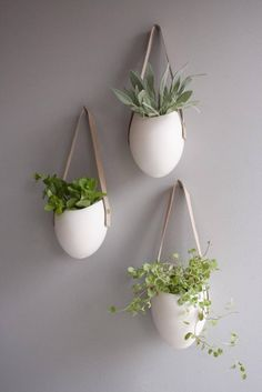 <p>A garden floats in polished porcelain. With clean curves that recall the simple perfection of river-polished stone. This planter elevates the room and accentuates the beauty of your houseplants with its simple but sculptural presence. Hang three in a harmonious trio or transform an entire wall into an installation of greenery. The smooth finish of high-fired porcelain is complemented by a vegetable-tanned leather strap that will just get better with age and wear.</p...