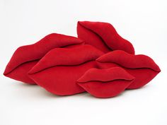 Scarlet Red   Lips Pillows    Red is soooo classic! These heart shaped pillows are made of 100% cotton Velveteen fabric. The Scarlet Red color is wonderfully vibrant and sassy. They are snuggly soft and durable, too.      $24 Mini (14x10)   $30 Classic (18x13)   $38 Big (22x16)   www.send-a-smooch.com