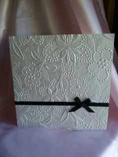 Embossed flowers with ribbon