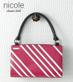 Nicole    With its candy-colored dark pink faux leather and contrasting white stripes, the Nicole for Classic Bags can be described as, well—sweetly scrumptious! This whimsical nod to the sweetheart in all of us is that perfect pop of color for your favorite neutral outfit. This is definitely a statement piece—what does it say about YOU?     https://purse-divas.miche.com/Shop/Product/1195