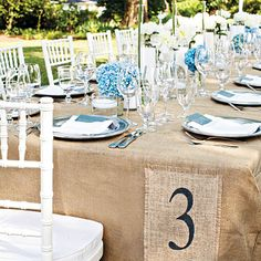 For a chic outdoor wedding, try using burlap as an alternative to traditional table linens to add texture and an organic feel.    Photo: Katie Stoops
