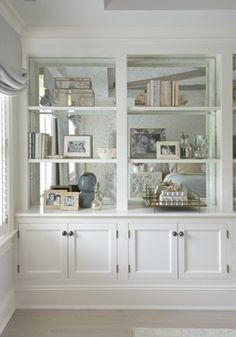 line backing of bookshelves with mirror