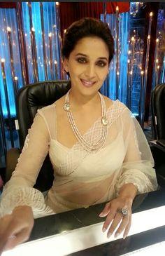 Madhuri Dixit in a sheer saree sari and blouse. Netted Blouse Designs, Saree Blouse Neck Designs, Fancy Blouse Designs, Blouse Patterns, Artisanats Denim, Net Blouses, Stylish Blouse Design, Stylish Sarees, Indian Designer Wear