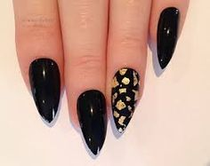 Stiletto Nails are on point.