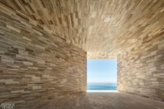 At the Solaz Los Cabos, a resort by Sordo Madaleno Arquitectos on Mexico's Baja California peninsula, a passageway sheathed in travertine marble frames a painterly view of the Sea of Cortés. Baja California, Beach Club, Mexican Colors, Lafont, San Jose Del Cabo, Landmark Hotel, Beautiful Sites, Suites, Arquitetura