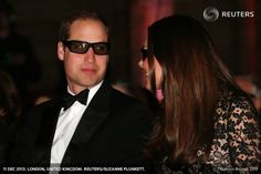 "Britain's Prince William and his wife Catherine, the Duchess of Cambridge, wear 3D glasses before a screening of ""David Attenborough's Natural History Museum Alive 3D"" at the Natural History Museum in London December 11, 2013. REUTERS/Suzanne Plunkett"