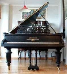 Grand piano in the front room
