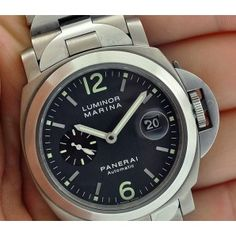 PANERAI PAM91 ANTHROCITE DIAL TITANIUM 44MM BRACELET  Pre-owned PANERAI PAM91 ANTHROCITE DIAL TITANIUM 44MM BRACELET. The watch is keeping good time and comes complete with boxes and papers.  Member Price: $6,295.00