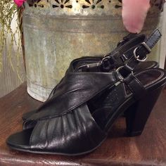 """New never wore. Cute and sassy black chunky heels Leather cross wrapped with peep toe. Heel is neat design and 3"""". Cute silver accents on both sides of straps. Strap adjustable. Mootsies Tootsies Shoes Heels"""