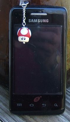 Super Mario-like Mushroom can dangle or perch on top your phone for oodles of attention. Old school style, this little guy (as a dangly) is only $15. Not bad for hand-made work.