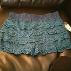 Rue 21 Lace shorts Brand new never worn teal lace shorts. Size Medium Rue 21 Shorts