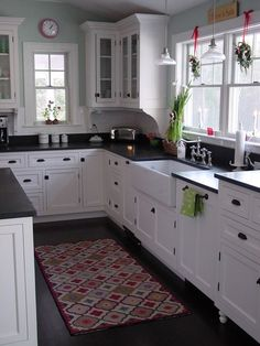 white cabinets, white farmhouse since, black countertops, natural light: