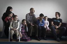 Samer (centre), surrounded by his wife and five children, tells  Orlando Bloom about being tortured in his homeland, and about the fears that his children still carry even after being in Jordan two years.