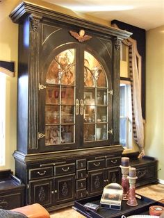 Beautiful handmade china cabinet or hutch made with a reclaimed arch window doors