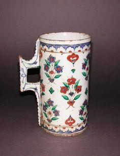 Maker:    Unknown; production    Category:    fritware (stonepaste)    Name(s):    tankard  Islamic pottery; category  Iznik; category    Date:    circa 1570 — circa 1585    School/Style:    Ottoman    Period:    late 16th Century: