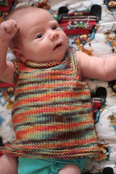 A sweet and simple vest, perfect for layering over a onesie or undershirt. The pattern is intended to be quick and easy (great for last minute gifting and beginner knitters!), and for those purl phobics, contains not a single purl stitch (accomplished by knitting the bottom band flat before joining in the round for the rest of the body)! The plain stockinette makes a perfect background for variegated yarns, as well as colorwork, stripes or other customization.