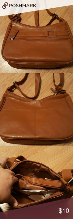 Camel Colored Purse New purse with multi pockets, 1 zipper and 2 open pockets outside, 1 zipper inside and 2 open inside. Puse measures 12x8x3.5. Strap adjusts from 14 inches to 22 inches. NWT Bags Shoulder Bags
