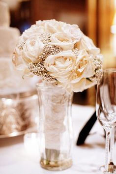 Put a vase at the head table for the brides bouquet