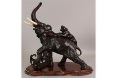 A GOOD QUALITY 19TH CENTURY JAPANESE MEIJI PERIOD BRONZE ELEPHANT & TIGER GROUP BY GENRUSAI SEIYA