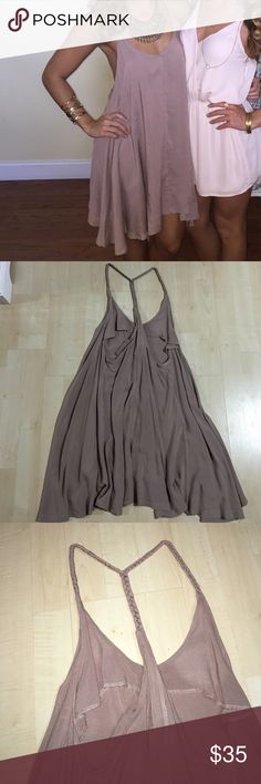 Tan braided straps dress This dress was purchases from tobi & worn ONCE for sorority recruitment. It has a deep V in the front & braided straps. It is flowy but flattering! It is shorter in the middle & a little longer on the sides. Size small (could possibly fit a medium). No trades, open to offers  Tobi Dresses Asymmetrical