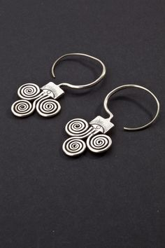 Guizhou, China | Silver earrings.  ca. 1st half 20th century