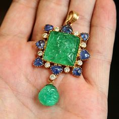 Carved emerald, sapphire and diamond pendant at Dupuis. #dupuis #jewels