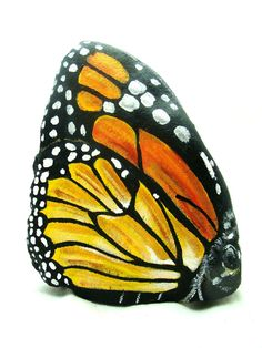 Monarch Butterfly stone hand painted on all sides resembling an actual butterfly.