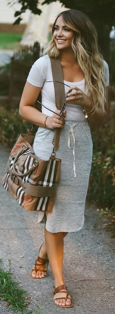 The bag is ugly but love her casual style and hair <3