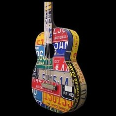 Bubby. This is what we need to do to his old guitar....license plate it!!