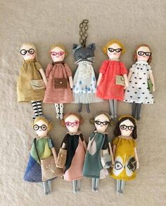 Lovely little dolls wearing glasses