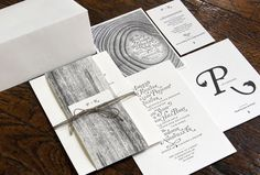 LOVE this. The invitation suite has a great nature theme (wood grain & tree rings), but the monochromatic black & grey evoke an ethereal, almost eerie feeling for me.