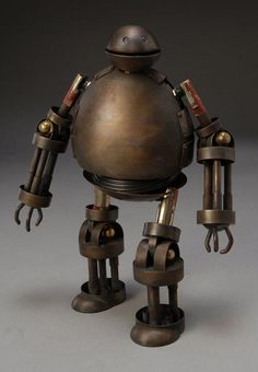 Robot created by James Ian Killinger It is my great pleasure to announce that October is Steampunk Month here on Mad Hatter& Bookshelf. Vintage Robots, Retro Robot, Arte Robot, Robot Art, Diy Robot, Art Steampunk, Sculpture Metal, Marionette, Art Antique