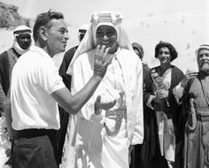 """David Lean directs a smiling Peter O'Toole somewhere in the Jordanian desert for the 1962 film """"Lawrence of Arabia"""""""