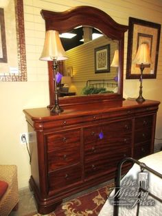 """Transitional style dresser with mirror in a medium finish. This piece has twelve drawers! Excellent amount of storage space. 68""""long x 19""""deep x 38""""high. At posting, we have the matching nightstand and chest. Arrived: Wednesday December 14th, 2016"""
