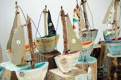 Sail away on one of Shirley Vauvelle's darling ships, made with driftwood, rusted nails, metal wire, pieces of vintage maps, and her own hand-formed earthenware creations.