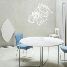 On a trip to one of the Ligne Roset stores I saw the F2 round folding dining table that has a top comprised of three triangular sections that fold flat