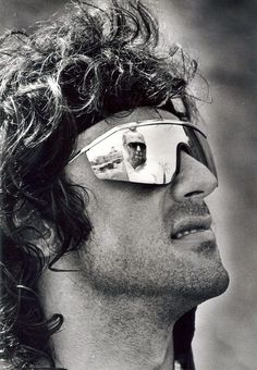 A young Sylvester Stallone in a cool pair or mirrored sunglasses.