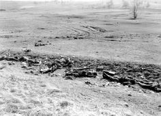 German KIAs lie on the skirmish line, probably mowed down by a machine gun burst, Utweiler, Germany, March 17, 1945. Note the Panzerfaust anti-tank weapon next to the KIA in the middle; a Sturmgewehr 44 Mkb42 assault rifle lies on the right of the picture.