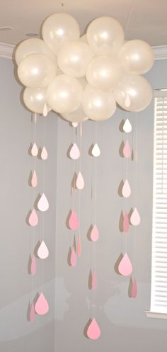 A cloud to literally shower the gift table.  These were paper raindrops that we sewed together for this baby shower decor!