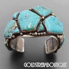 Metal: Silver Metal Purity: .925 Hallmark: R Sterling Artisan: Ray Fierro Tribe Affiliation: Navajo Wearable Length ( inches ): 8 Including gap 1.5 Width ( inches / mm ): 2.83 / 72.0 Weight ( gram ):