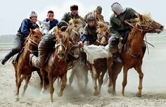 Two teams of Kazakh riders fight for a goat's body during a game of the national sport, kokpar, in Pavlodar, May 13, 2001. (Reuters)