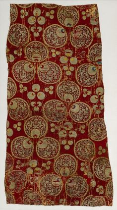 Fragment of a Dress or Furnishing Fabric with 'Chintamani' Design Turkey, Bursa or Istanbul, mid-16th century Textiles Silk satin with silk and silver-metallic supplementary weft patterning bound in twill (lampas)