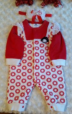 This is a cute Red n White Baby Outfit. The Fabric is nice and heavy for Winter.  It comes with a matching Red n White Headband.  Would look cute with the Red n White Winter boots , too. Check them out here: https://www.etsy.com/listing/470473278/free-shipping-size-1-2-red-n-white-baby?ref=shop_home_active_1